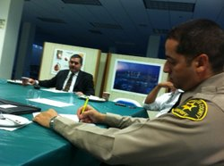 L.A. County Deputy Sheriff Sherif Morsi meets with other men and women from t...