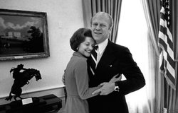 Former First Lady Betty Ford with her arms around her husband, former U.S. President Gerald R. Ford, in the White House Oval Office.