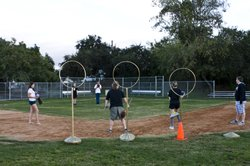 For this practice, only three gold hoops are set up, since it's a smaller gro...
