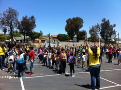 Students at Kellogg Elementary School stretch before the schools first annual year-end fitness fair in Chula Vista, May 26, 2011.