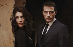 "Caterina Murino as Tania Moretti, and Rufus Sewell as detective Aurelio Zen in ""Masterpiece Mystery! Zen"""