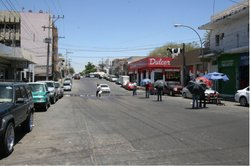 Parasols line the street in El Mercadito - the Little Market - a neighborhood...