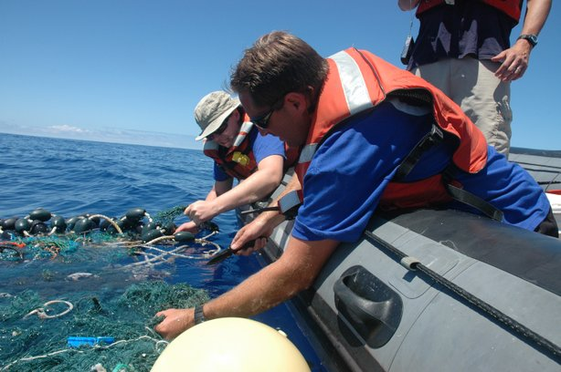 While deployed in a small boat, SEAPLEX researchers encountered a large ghost net with tangled rope, net, plastic, and various biological organisms.