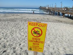 A sign warning people not to swim in Imperial Beach after a sewage spill in J...