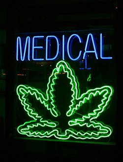 A sign at a medical marijuana dispensary in Santa Monica is pictured in this ...