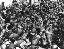 Normandy Invasion, June 1944. Army troops on board a LCT, ready to ride across the English Channel to France. Some of these men wear 101st Airborne Division insignia. Photograph released June 12, 1944.