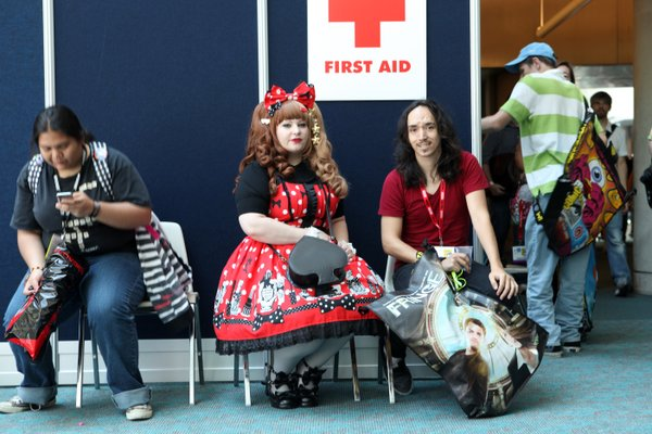 A woman dressed in the Lolita style takes a rest during 2011 Comic-Con International.