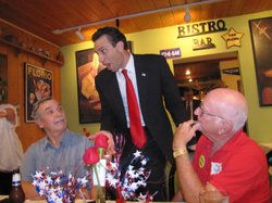 Arizona state Senator Steve Smith talks with supporters at a fundraiser for a private border fence at Tommy's Bistro in Casa Grande, Arizona.