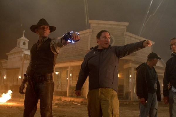 "Daniel Craig and Jon Favreau on the set for ""Cowboys and Aliens."""