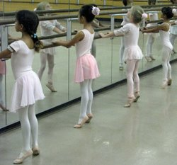 Tiny aspiring ballerinas practice a a camp run by the San Diego Civic Youth B...