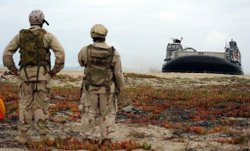 SAILORS WATCH AS LANDING CRAFT ARRIVES AT CORONADO ISLAND