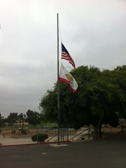 Flags fly at half staff in Colina Del Sol park in City Heights on August 11, ...