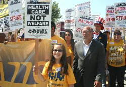 More than a thousand grocery workers joined by community, labor, and clergy rallied at all three Vons, Albertsons, and Ralphs' corporate headquarters to demand health care not welfare, June 28, 2011 in Los Angeles, California.