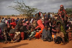 Somalian refugees wait in the registration area of the Ifo refugee camp which makes up part of the giant Dadaab refugee settlement on July 20, 2011 in Dadaab, Kenya.