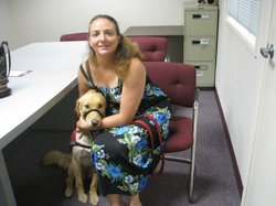 Veteran Kate Raggazino and her dog Daisy May. Daisy May helps Raggazino remember when she needs to take her medications. August 2011