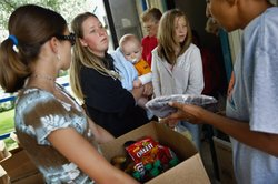 Ashley Shannon and her son Quinton Pilling, 7 months, receive a box of food aid delivered by the Care and Share food bank in the rural town of Hugo, in eastern Colorado.