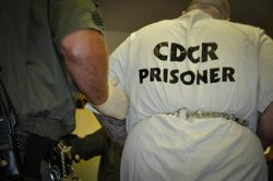Correctional officer escorts an inmate who denounced his gang membership and is scheduled to transfer out of the SHU-- back to his cell. Pelican Bay officials gave reporters 15 minutes to interview the inmate.