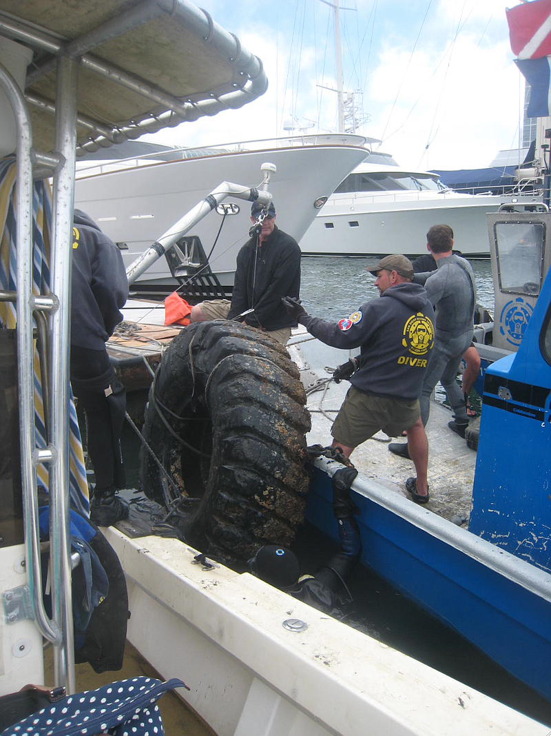 A tire pulled from the bottom of San Diego by Operation Clean Sweep volunteer...
