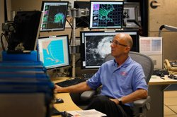 Senior hurricane specialist Lixion Avila studies computer models as he tracks...