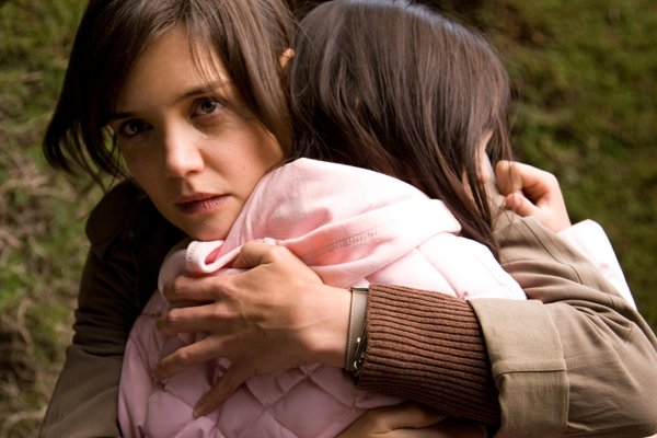 "Katie Holmes plays a woman who sympathizes with a young girl's fears of an old house in ""Don't Be Afraid of the Dark."""