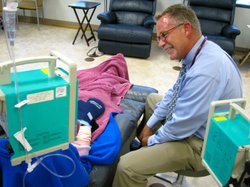 Nurse practitioner Scott Shuford tries to lighten the mood with his patients ...