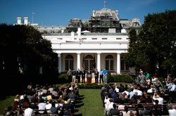 U.S. President Barack Obama (C) delivers a statement demanding that Congress to pass extensions of transportation and avaition bills with labor, business and political leaders and workers who would be affected if Congress fails to act in the Rose Garden August 31, 2011 in Washington, DC.