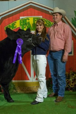 Students posing with their winning livestock at the annual Jr. Livestock Auction, Big Fresno Fair.
