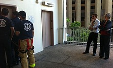 SDFD work on getting the woman out of the elevator on Sept. 8, 2011.
