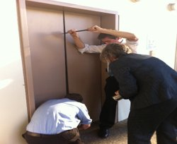 Councilwoman Sherri Lightner and members of her staff try to extract a colleague stuck in an elevator during Thursday's countywide power outage.