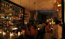 Jayne's Gastropub in San Diego is lit by candlelight during the blackout on S...