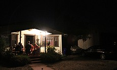 A family sits out on the porch during the San D...