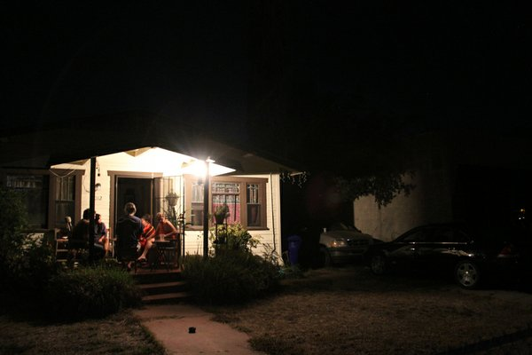 A family sits out on the porch during the San Diego blackout on Sept. 8, 2011.