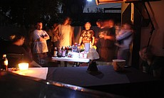 Neighbors and friends took advantage of the blackout to grill food and relax under the stars. Here, neighbors gather in University Heights on Sept. 8, 2011.