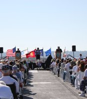 Several special guests, local dignitaries and New York City fire fighters speaking at USS Midway ceremony.