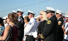 Retired New York City Fire Fighters organized the 9/11 tribute aboard the USS Midway.