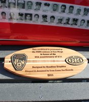 Surfboard memorial featuring 9/11 fire fighters.