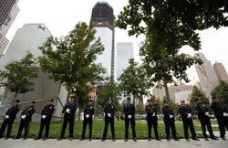 NYPD officers, FDNY firefighters and Port Authority Police line up at one of the entrances of 9/11 Memorial Plaza during the tenth anniversary ceremonies of the September 11, 2001 terrorist attacks at the World Trade Center site, September 11, 2011 in New York City.