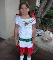 8-year old Naomi Tanaka shows off her authentic Mexican dress.