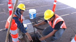 Pedro Bernal (left) and Jonathan Escoto (right) work on their first job as part of the IBEW apprenticeship program.