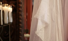 A detailed look at the cheesecloth in Parish's design, which also has connota...