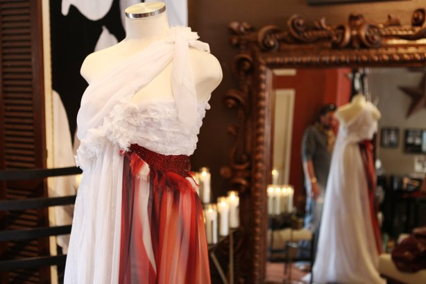 """A close detail of the dress as Parish examines his """"imperfectly perfect"""" design."""