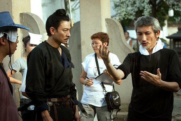 "Andy Lau takes direction from Hong Kong legend Tsui Hark on the set of ""Detective Dee and the Mystery of the Phantom Flame."""