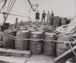Prohibition agents examine liquor confiscated from a captured rum runner in 1924. Usually, they weren't so lucky.