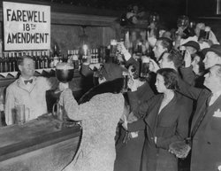 Speakeasy patrons offer a farewell toast to prohibition.