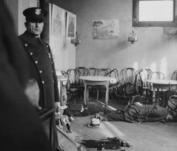 A policeman guards a gangland murder scene in a Cleveland restaurant, 1932.