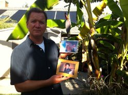 Trevor Richardson shows a photo of Andrew, his six year-old son who was abducted.