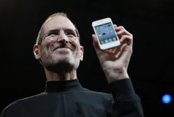 Steve Jobs holds up an iPhone at the Apple Worldwide Developers Conference in...
