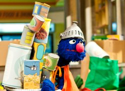 "Grover donated canned food to the food drive to help others in need as part of Sesame Street's primetime television special ""Growing Hope Against Hunger."" © 2011 Sesame Workshop."