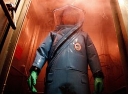 A researcher wears a biohazard suit at Fort Detrick, Md., where the FBI says ...