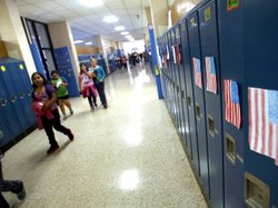 Students walk through the hallways of West Liberty Elementary School. Schools...